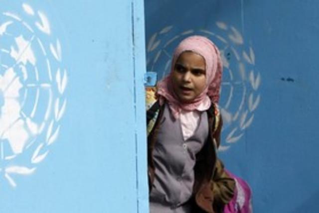 Palestinian girl at UNRWA school 311 Reu (photo credit: Ali Hashisho / Reuters)
