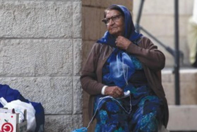 A poor woman poverty impoverished homeless 311 (photo credit: Marc Israel Sellem/The Jerusalem Post)