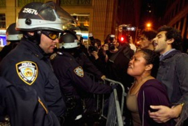 Occupy Wall Street protesters clash with NY police 311 (R) (photo credit: REUTERS/Lucas Jackson)