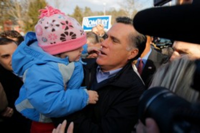 Mitt Romney holds a child at a campaign event 311 (R) (photo credit: REUTERS/Brian Snyder)