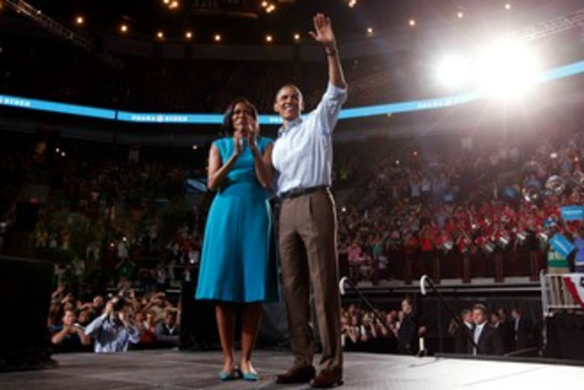 Barack Obama with wife at Ohio rally 370 (photo credit: REUTERS/Kevin Lamarque )