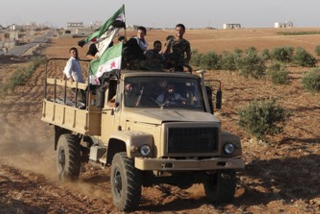 Free Syria Army fighters in Saraqeb 370 (R) (photo credit: REUTERS / Handout)