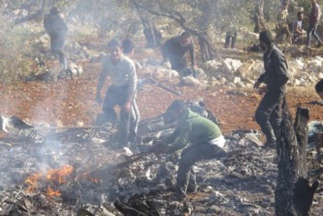 Burning wreckage of  Syrian warplane 370 (photo credit: REUTERS/Abdalghne Karoof)