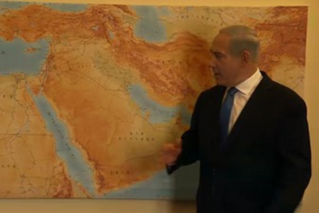 PM points to map in Likud Beytenu campaign video 370 (photo credit: Screenshot)