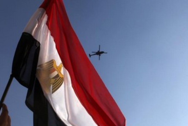 Egypt flag waving with helicopter in background 370 (photo credit: REUTERS/Asmaa Waguih)