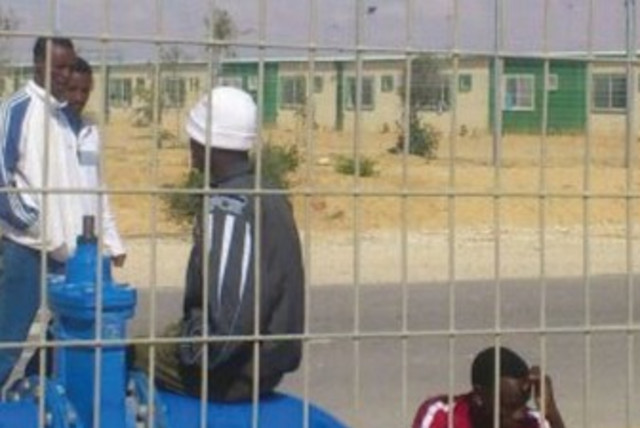 DETAINEES PASS the time  at the Holot detention facility in the western Negev. (photo credit: BEN HARTMAN)