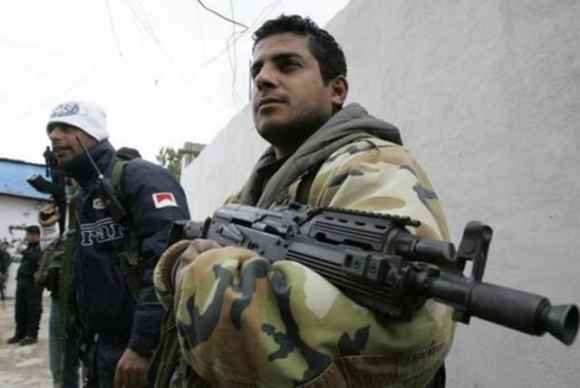 Armed Fatah men at Mieh Mieh camp in Lebanon (photo credit: REUTERS)