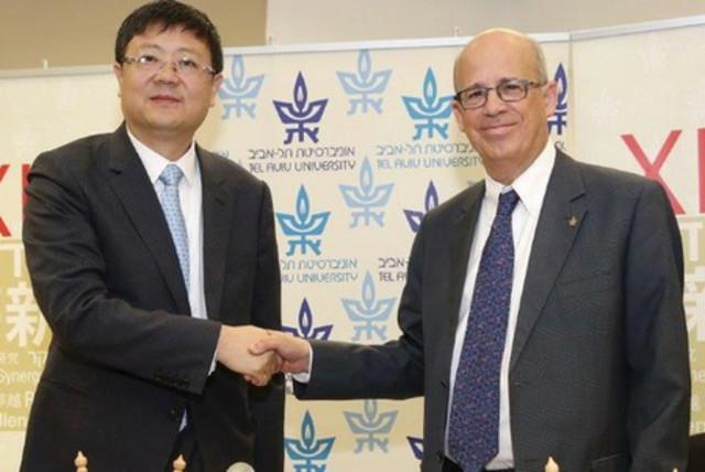 Tsinghua University president Jining Chen (left) meets with Tel Aviv University president Joseph Klafter at TAU. (photo credit: TAU)