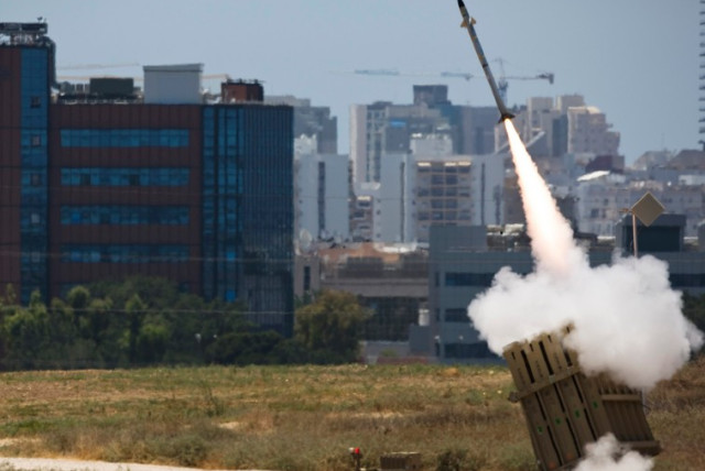An Iron Dome launcher fires an interceptor rocket in the southern Israeli city of Ashdod (photo credit: REUTERS)