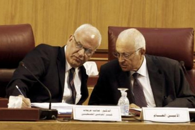 Palestinian chief negotiator Saeb Erekat (L) talks with Arab League Chief Nabil el-Araby during their meeting at the Arab League in Cairo August 11, 2014. (photo credit: REUTERS)
