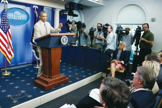 US president Barack Obama addresses reporters in the White House press briefing room, (photo credit: REUTERS)