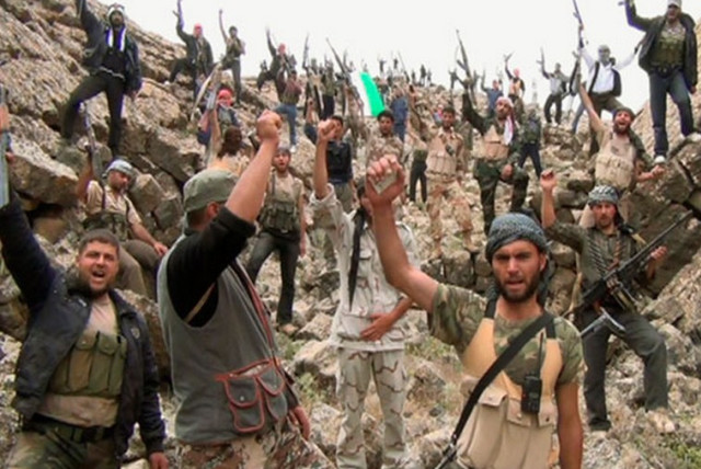 Syrian rebels fighting the Assad regime celebrate. (photo credit: REUTERS)