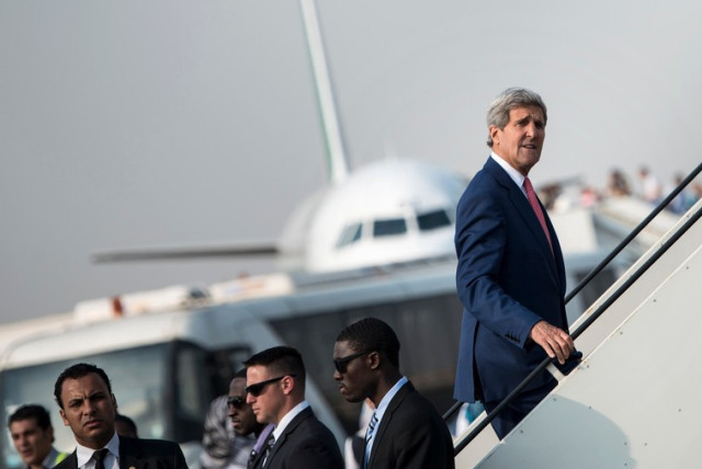 US Secretary of State John Kerry boards his plane (photo credit: REUTERS)