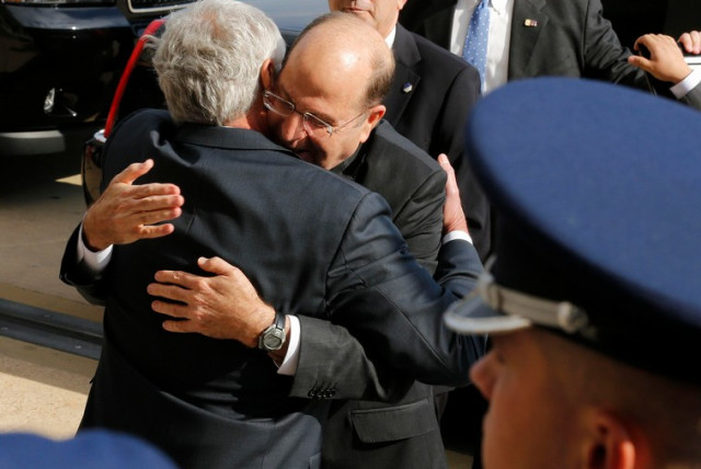 US Secretary of Defense Chuck Hagel is hugged by Defense Minister Moshe Yaalon at an Honor Cordon at the Pentagon, October 21 (photo credit: REUTERS)
