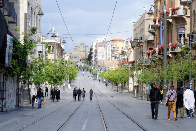 People walk down Jaffa Street in Jerusalem on a Shabbat afternoon. (photo credit: ONDREJ ŽVÁCEK/WIKIMEDIA COMMONS)