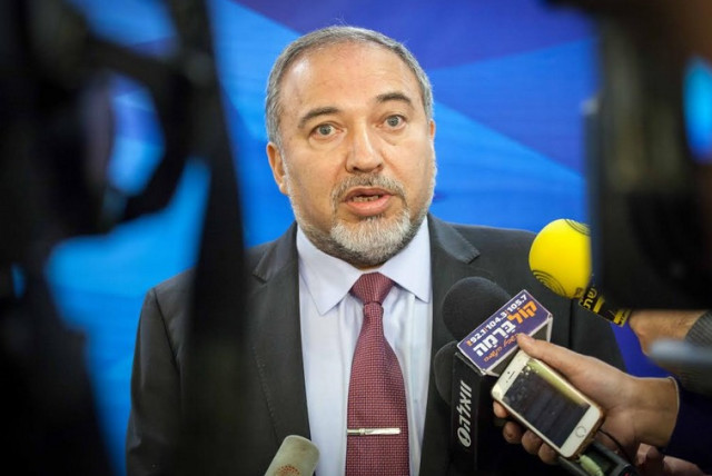 Foreign Minister Avigdor Liberman speaks to the press before the weekly cabinet meeting in Jerusalem (photo credit: EMIL SALMAN/POOL)