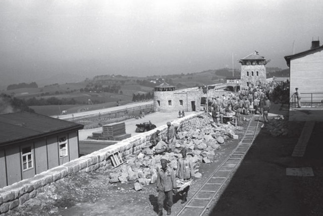 Prisoners work in the Mauthausen-Gusen concentration camp during World War II. (photo credit: Wikimedia Commons)