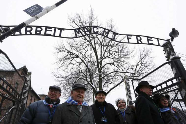 Survivors of the former Nazi German concentration and extermination camp Auschwitz arrive to the former camp in Oswiecim. (photo credit: REUTERS)