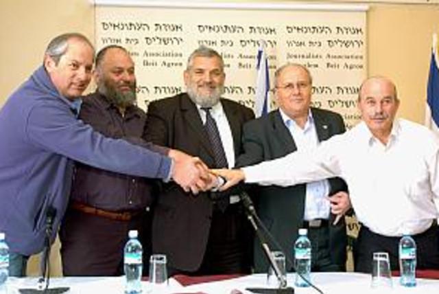NRP, NU mks shake hands (photo credit: Ariel Jerozolimski)