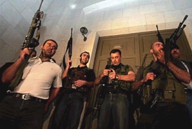 pals with guns 298.88 ap (photo credit: AP [file])