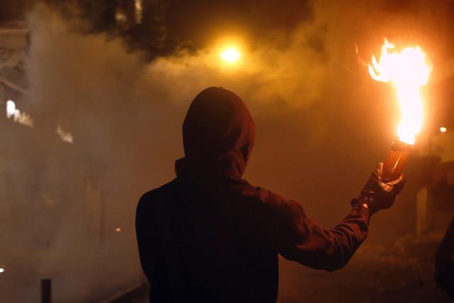 Molotov cocktail in hand (photo credit: YANNIS BEHRAKIS/REUTERS)