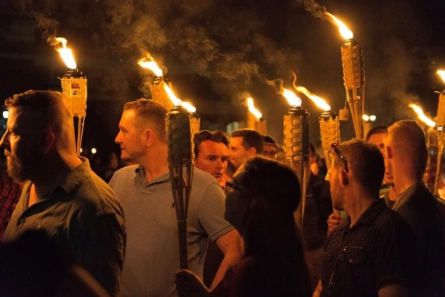 White nationalists carry torches on the grounds of the University of Virginia, on the eve of a planned Unite The Right rally in Charlottesville, Virginia (photo credit: ALEJANDRO ALVAREZ/NEWS2SHARE VIA REUTERS)