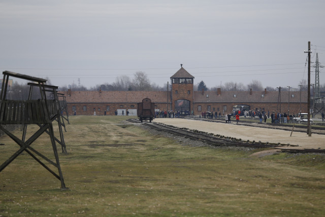 Visitors gather on the grounds of the former Nazi German concentration and extermination camp Auschwitz-Birkenau (photo credit: REUTERS)