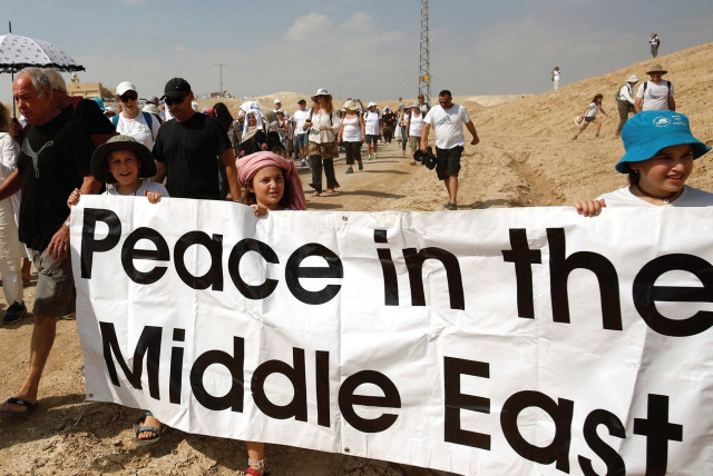 DEMONSTRATORS, INCLUDING Israeli and Palestinian activists, take part in a demonstration in support of peace last year (photo credit: REUTERS)