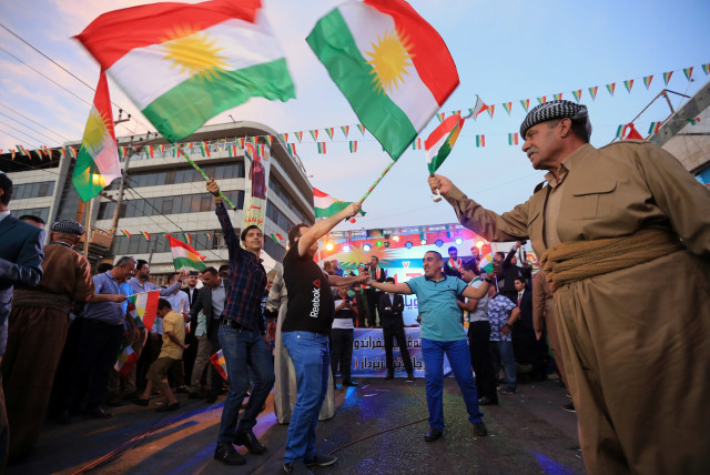 Kurds celebrate to show their support for the independence referendum in Duhok, Iraq, September 26, 2017. (photo credit: REUTERS)