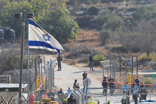 A general view shows where a Palestinian terrorist killed three Israeli guards and wounded a fourth before being killed himself in Har Adar yesterday. (photo credit: AMMAR AWAD / REUTERS)