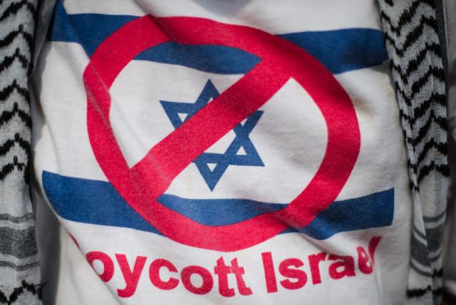 A supporter wears a T-shirt reading 'Boycott Israel' (photo credit: AFP/ MOHD RASFAN)