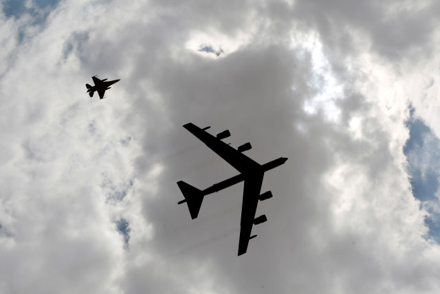 A U.S. B52 plane (R) flies during Exercise Eager Lion at one of the Jordanian military bases in Zarqa, east of Amman, Jordan, May 24, 2016.  (photo credit: MUHAMMAD HAMED / REUTERS)