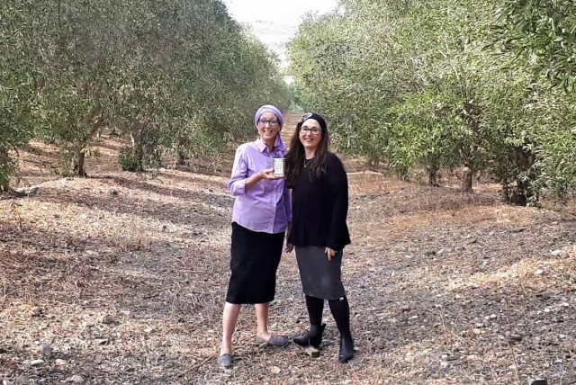 Chana Veffer (left) and Nili Abrahams in the orchards of Degania. (photo credit: GALILEE GREEN)