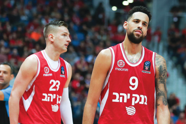 Hapoel Jerusalem forward Austin Daye (right) had every reason to look dejected last night after the team dropped to a 92-75 defeat at Buducnost in Eurocup action in Montenegro. (photo credit: DANNY MARON)