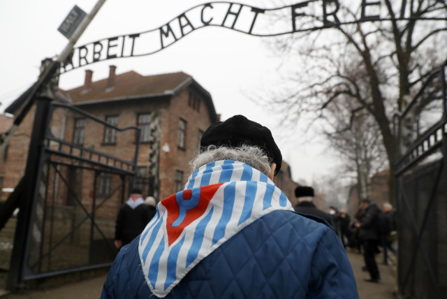 Holocaust survivors enter Auschwitz 73 years after its liberation on Holocaust Remembrance Day, January 2018 (photo credit: KACPER PEMPEL / REUTERS)