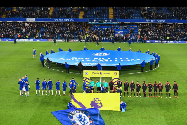 """A banner reading """"Say No To Antisemitism"""" is unfurled at midfield before Chelsea F.C.'s match on January 31, 2018, kicking off the club's campaign to fight antisemitism. (photo credit: CHELSEA FOOTBALL CLUB)"""