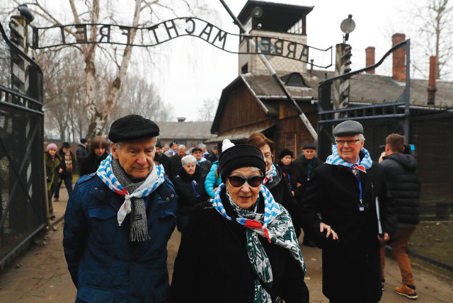 HOLOCAUST SURVIVORS visit the site of the Auschwitz death camp, during ceremonies marking the 73rd anniversary of the camp's liberation and International Holocaust Victims Remembrance Day, in Poland in January 2018.. (photo credit: KACPER PEMPEL / REUTERS)
