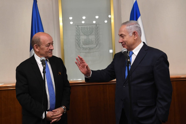 Prime Minister Benjamin Netanyahu meets with French Foreign Minister Jean-Yves Le Drian in Jerusalem on March 26, 2018, following a hostage attack in France (photo credit: KOBI GIDEON/GPO)