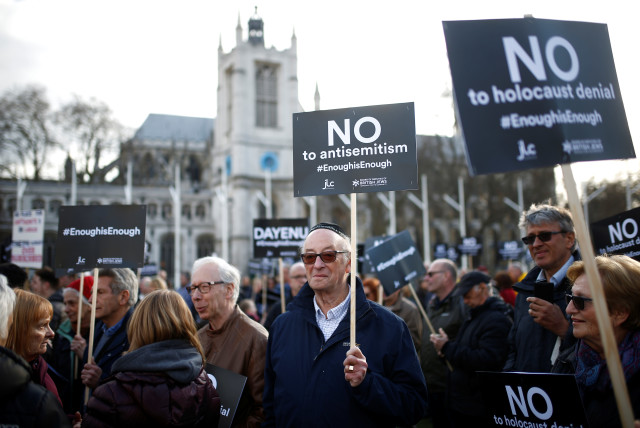 Protesters participate in a demonstration against antisemitism in Parliament Square in London, Britain, March 26, 2018 (photo credit: HENRY NICHOLLS/REUTERS)