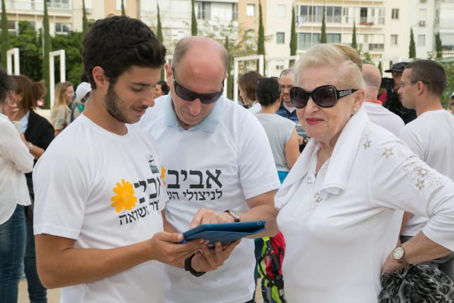 Volunteers from Aviv LeNitzolei HaShoah (photo credit: BENI LAPID)