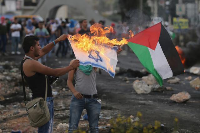 Palestinians prepare to burn Israeli flags on third weekend of protests -  The Jerusalem Post
