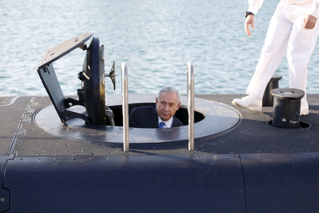 Prime Minister Benjamin Netanyahu climbs out after a visit inside the Rahav, the fifth submarine in the fleet, after it arrived in Haifa's port (photo credit: BAZ RATNER/REUTERS)