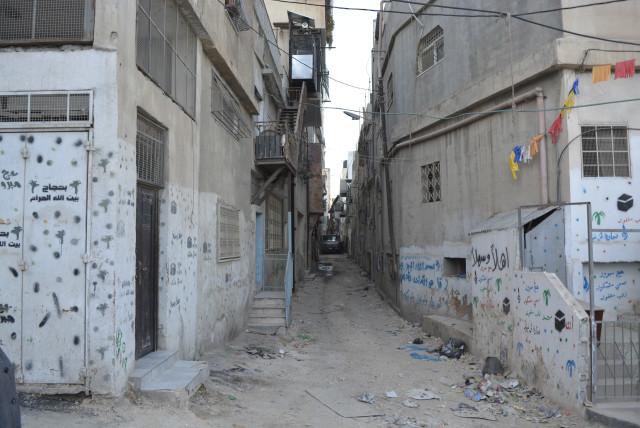 A narrow alleyway inside Shuafat Refugee Camp (photo credit: UDI SHAHAM)