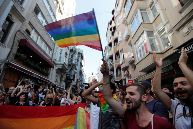 Members of LGBT community take part in a Gay Pride parade in central Istanbul, Turkey, July 1, 2018 (photo credit: OSMAN ORSAL/REUTERS)
