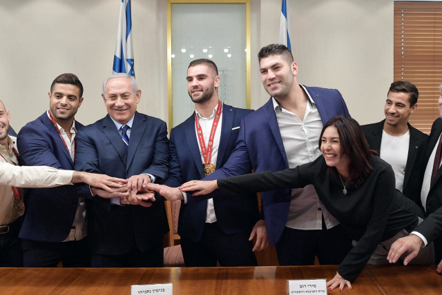 Israeli Judokas meet with Prime Minister Benjamin Netanyahu and Culture and Sports Minister Miri Regev at the Prime Minister's office on Thursday, November 8, 2018 (photo credit: GPO/AMOS BEN GERSHOM)