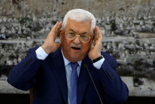 PALESTINIAN PRESIDENT Mahmoud Abbas – not saying anything about the elections, but working behind the scenes? (photo credit: MOHAMAD TOROKMAN/REUTERS)