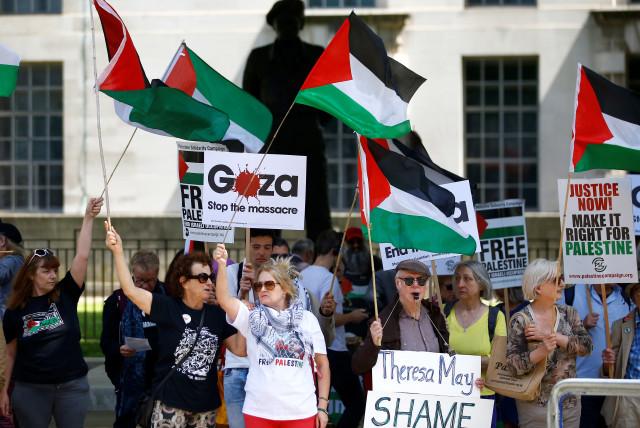 Pro-Palestinian demonstrators protest in London in June 2018.  (photo credit: HENRY NICHOLLS/REUTERS)
