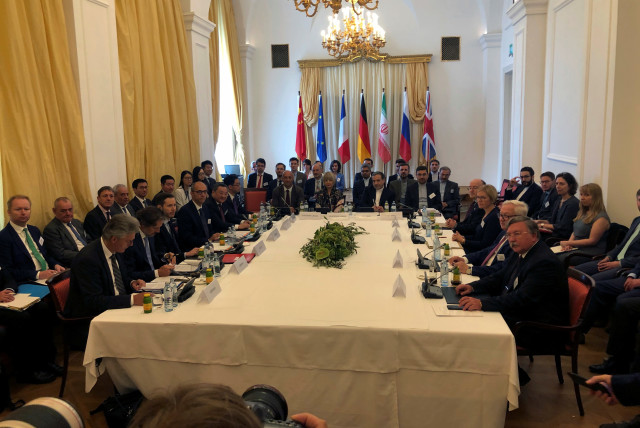 Iran's top nuclear negotiator Abbas Araqchi and EEAS Secretary General Helga Schmid attend a meeting of the JCPOA Joint Commission in Vienna, Austria to discuss the Iran nuclear deal (photo credit: REUTERS/KIRSTI KNOLLE)