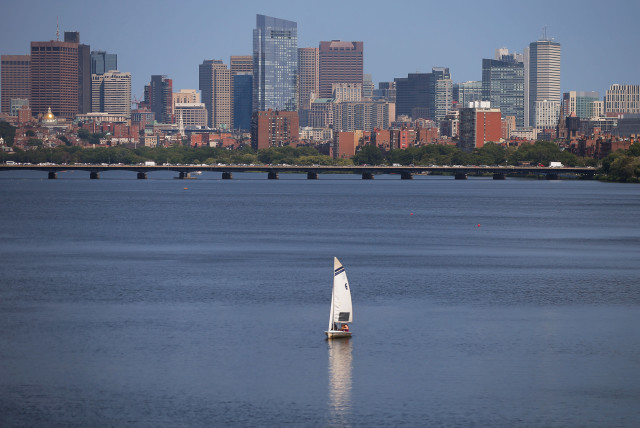 the Charles River in front of the skyline of Boston (photo credit: BRIAN SNYDER/REUTERS)