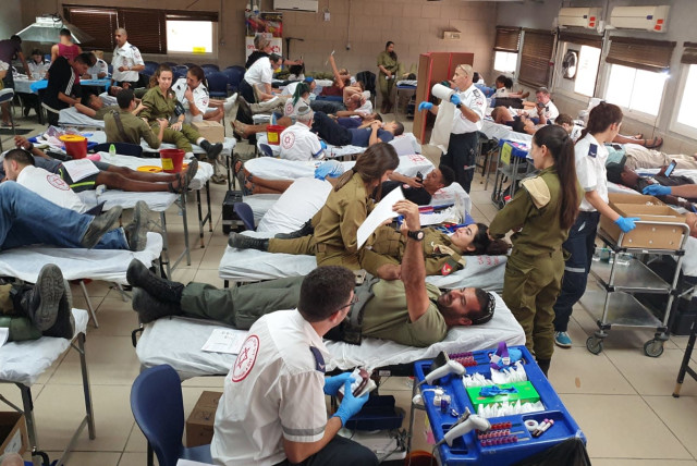 """""""Blood Brothers"""" blood donation campaign by IDF and MDA, Oct. 2019 (photo credit: MAGEN DAVID ADOM)"""